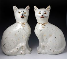 Antique pottery figures of seated cats  Victorian period. A rare pair of white pottery seated cats from the Alloa Pottery in Scotland. The cats are naively modelled which gives them a very whimsical charm. The cat seated on the right is missing one side of his whiskers and this feature adds a unique ch...    $ 2880
