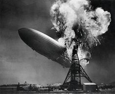 "May 6, 1937, the hydrogen-filled German dirigible ""Hindenburg"" bursts into flames and crashes while docking in Lakehurst, New Jersey, killing 36 out  of the 97 on board."