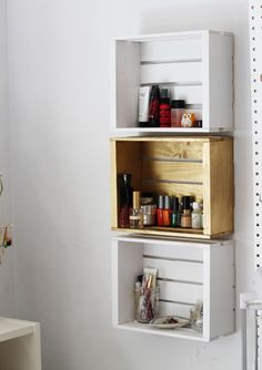Make old crates useful by hanging them on the wall, like this clever two-tone shelving from Acute Designs. Here, she uses them to store her makeup and nail polish — but you could also stock them with spices or knick-knacks. See more at Acute Designs »