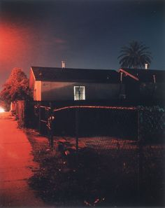 """I'm an art photographer,"" Todd Hido explained. ""I just do photos of suburban neighborhoods. Long-exposure stuff.""    ""Well,"" the guy said, ""be careful. The cars come roaring through here.""    ""Yeah, thanks."""