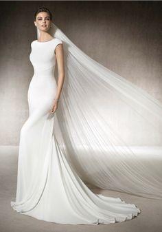St. Patrick | Mermaid wedding dress in crepe with a wonderful boat neck neckline…