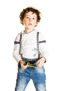 Stylish little boy - Shooting in the studio on a white background.