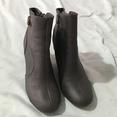 Super cute grey ankle boots These boots are so super cute! I can't wear heels anymore so I have to part with them. 3 1/2 inch wedge. Old Navy Shoes Ankle Boots & Booties