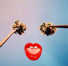 Californian summer. Blue Sky, Palm trees and red lips.