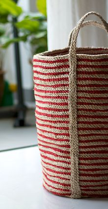 The beautiful Santorini Floor Basket in natural/red fine stripe. $140