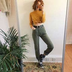 (SOLD) Rare olive green Levi's 501s. High waisted straight leg fit in mom jeans style, with the classic button up flies and orange tag on the back of the hip. Super thick green denim, that will last you a lifetime  will best fit size 10 or a size 8 with a