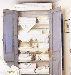 Perfect touch of color- love the idea of painting the interior of cabinets a different color