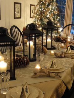 Christmas Table...love the simplicity of the lanterns and pine cones.