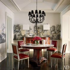 30 Amazing Celebrity Dining Rooms via AD  - Brooke Shields collaborated with decorator David Flint Wood and MADE architects on the Manhattan townhouse she shares with her family. Zuber's Les Lointains pattern evokes an enchanting mood in the dining room, where a tole chandelier is mounted over a vintage marble-top table by Ralph Lauren Home and chairs by Jansen.