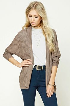 An open-knit cardigan featuring long dolman sleeves, an open front, and ribbed trim.