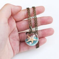 Natural beach in a glass Sea pendant Mini vial globe bottle Tiny round ball Real miniature shell pearl starfish Customizable necklace