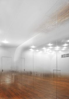 Beijing based architects Tsutsumi and Associates have completed this dance studio in Beijing with mirrored walls covered in tiny graduated dots to create the illusion of a mist hanging in the air. Studios Architecture, Interior Architecture, Living Comedor, Interior Decorating, Interior Design, Studio Interior, Decorating Tips, Dance Studio, Commercial Interiors
