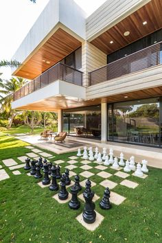 Landscaping Ideas - Liven Up Your Backyard With Some Games // The backyard of this modern home has a built-in chess set.