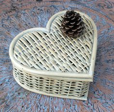 Cute idea for gift basket:  Heart Shaped Wicker Basket with Hinged Lid. $14.00, via Etsy.