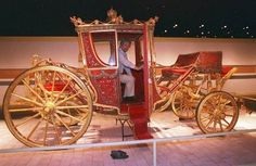 Vladimir Chernyshev, Hermitage curator of carriages, inspects the 1896 coronation coach of Czar Nicholas II on Friday, July 24, 1998 in Wilmington, Delaware.