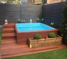 Contemporary small backyard with wooden deck, fence and pool | http://instagram.com/p/BO7hhP0FySd/