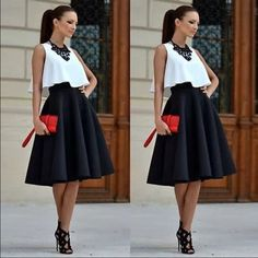 White top and black skirt set. White top and black skater skirt set. Top O-neck, skirt knee length. Material cotton/polyester. Skirts Skirt Sets