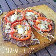 Calabaci-pizza 1 calabacín grande 1 cucharadita de harina de almendras 1 huevo entero 1 tarrina de queso de burgos 0% Especias italia