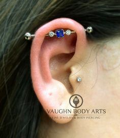 Atrin's fresh industrial piercing with an Anatometal  implant grade titanium barbell, 4mm princess cut sapphire and two 3mm CZ's...