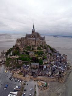 Mont Saint-Michel is a rocky tidal island and a commune in Normandy, France. It is located approximately one kilometre off the country's north-western coast, at the mouth of the Couesnon River near Avranches  ~~ Mont St Michel by Pierre Lesage, via Flickr