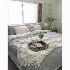 Farm Fresh Homestead. Neutral farmhouse master  bedroom. Subtle striped duvet cover