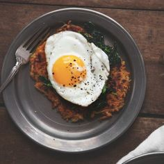 Butternut squash potato pancakes with spinach and fried eggs.