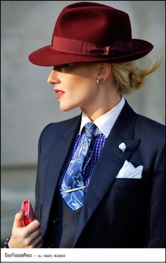 Red hat. Quite striking. If only I had that jawline.