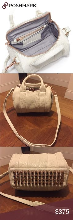 "NEW ALEXANDER WANG Ivory Rose Gold Rockie Guaranteed Authentic. Org retail: $800. New, never worn. Pebbled lamb Rockie, with Rose Gold hardware. 2 hidden side zippers. Adjustable/detachable shoulder strap. Lined interior: 1 zip pocket, 2 slip pockets. 10""L, 9""H, 7.5""W. Faint mark on the side, at the back, & next to handle. NO TRADES. Open to offers through the offer button ☺️ Alexander Wang Bags Crossbody Bags"