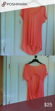 New~ Peach Oversized Tee W/ Opened Back Boutique ~ New~ Peach Oversized Tee W/ Opened Back Size XL is the only/ 100% Rayon/No Trades! Thanks! Boutique Tops Tees - Short Sleeve
