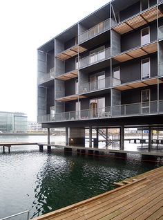 teglværkshavnen housing, copenhagen denmark, 2003-2008. architects: tegnestuen vandkunsten. winter building site. people are moving in to the first completed buildings. the project is 50% subsidized or social housing and 50% private ownership. you are looking at part of the social housing. www.vandkunsten.com