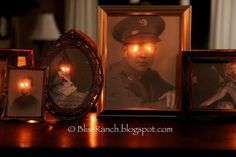 Framed photos with holes punched out for lighted eyes ~ Paranormal Pictures for Halloween ~ BlissRanch