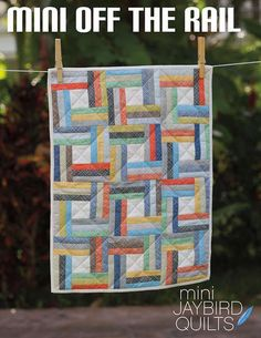 A modern spin on a traditional favorite and then miniaturized! You will need: - (1) Charm Pack or (28) 5 inch squares - (1) Fat Eighth binding fabric - (1) Fat Quarter backing fabric - 15 inch by 20 i