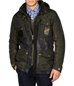 AGADY Impeccably designed and tailored field jacket with a vintage-inspired ethos and utterly contemporary construction. Wool camo panels blend seamlessly with stylized quilting on the outer shell and the inside is lined in an inspired flag motif. The hood is detachable for greater versatility and the entire jacket is padded in Thermore EVOdown®, an innovative material that shares the same qualities as down feathers but is machine washable.