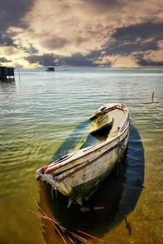 Old wooden boat, weathered, drowning, cloudy, clouds, water, beauty of Nature, stunning, peaceful, solitude