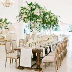 Never wake us up from this beautiful wedding dream! • set on the beach in naples, fl this gorgeous @annaluciaevents design is everything  • featuring custom embroidered runners and fitted linens with sage-hued detailing • see the full story in @wueditor • lush blooms by @50fiftycreativeservices • dreamy sail cloth tent from @sperrytents • lovely photos by @ktmerry