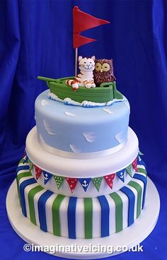 So cute! Not such a fan of the bottom of the cake or the colours but love the theme :)