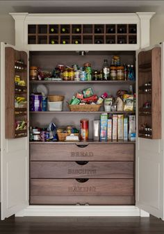 Any home decor needs a Kitchen Pantry Cabinet. Love the addition of the wine…