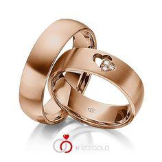 1 Paar Trauringe - Legierung: Rotgold 585/- Breite: 6,00 - Höhe: 1,80 - Steinbesatz: 3 Brillanten zus. 0,03 ct. tw, si (Ring 1 mit Steinbesatz, Ring 2 ohne Steinbesatz)