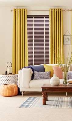 Bright colours, patterns and natural textures create a beautiful globally inspired eclectic interior. Keep your walls plainly decoration to build impact with accessories. Made to measure Wooden Blinds and Curtains add a perfect backdrop to this look. Bedroom Curtains With Blinds, Living Room Blinds, Diy Blinds, House Blinds, Yellow Curtains, Wood Blinds, Colorful Curtains, Living Room Decor, Bright Curtains