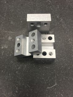 A smaller hose containment block that is part of a much larger family used internally and externally in multiple robotic applications. These parts are machined alluminum and made on our 4-Axis CNC. #MadeInUSA #Manutec #USManufacturing #CNC #4thAxis #Aluminum #PrecisionMachining #PrecisionMachined #MachinedAluminum #MadeInMichigan #MichiganMade #AmericanMade #RobotParts #Robotics #Automation #Integration