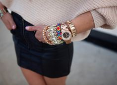 Excessive gold accessories & mini skirt <3
