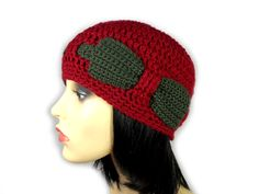 This bright burgundy red beanie hat is accented with a dark green interweaved crocheted band and a pretty matching bow. It is beautifully soft and warm. It can be worn either casually or with a more elegant outfit. Either way, it is a must have accessory in any girl's wardrobe. Red Beanie Hat, Girls Wardrobe, Elegant Outfit, Burgundy, Crochet Hats, Bows, Bright, Warm, Pretty