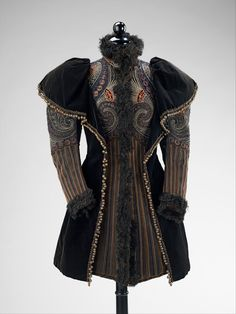 "Pingat mantle, 1893. ""This fine example of Pingat's outerwear is ornately embroidered in a style which shows his interest in other cultures. This high style interpretation is superbly executed with a level of detail which is consistent among the best work of the famous French couturiers."""