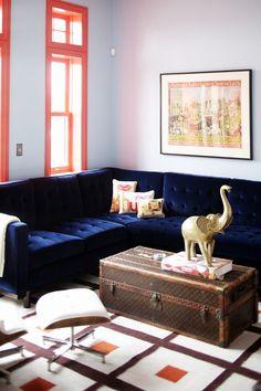 navy velvet couch & coral window trim