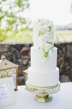 White peony topped wedding cake: http://www.stylemepretty.com/california-weddings/geyserville-california/2016/04/30/this-multicultural-napa-valley-wedding-will-convince-you-to-embrace-color/ | Photography: http://www.onelove-photo.com/