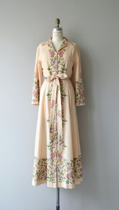 Amazing vintage 1960s cream, lightweight wool coat with enchanting pastel embroidery on front, back, sleeves and hem. Wool loop buttons, bell sleeves, tie belt and full lining. See? Amazing. --- M E A S U R E M E N T S ---  fits like: medium/large shoulder: 17 bust: 38-42 waist: up to 32, ties smaller to fit as well hip: free sleeve: 22 length: 54 brand/maker: n/a condition: presents nearly perfect with some scattered moth nips  ➸ More vintage coats…