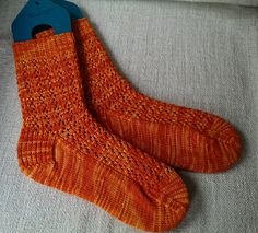 Mercury Socks by Kim Drotar This is a simple lace sock knit cuff down with a gusset heel. There are four size options so everybody should be able to find the right fit! Knitted Socks Free Pattern, Loom Knitting Patterns, Crochet Mittens, Knitted Slippers, Knitting Socks, Baby Knitting, Knit Socks, Knitting Tutorials, Knitting Machine