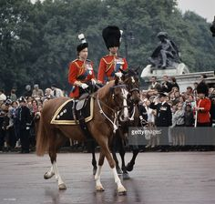 Queen Elizabeth II and Prince Philip return to Buckingham Palace in London after the Trooping The Colour ceremony, 12th June 1965.