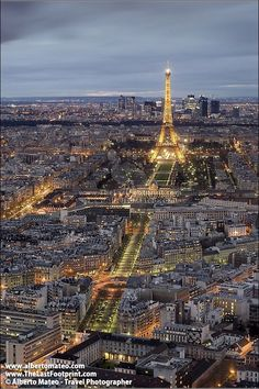 Eiffel Tower at dusk, aerial view of Paris, France.