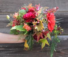 Love the dahlias, succulents, tillandsias, ferns & fall leaves. Don't like the roses in there so much.
